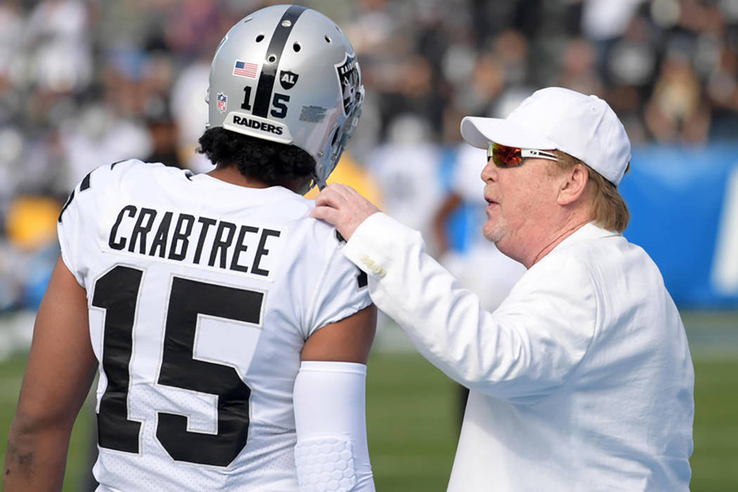 Oakland Raiders wide receiver Michael Crabtree (15) talks with owner Mark Davis during an NFL football game against the Los Angeles Chargers at StubHub Center. (Kirby Lee/USA Today Sports)