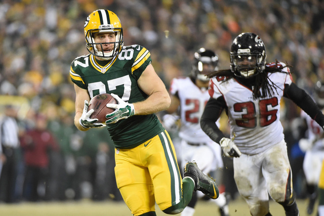 Green Bay Packers wide receiver Jordy Nelson (87) runs past Atlanta Falcons safety Kemal Ishmael (36) to score a touchdown after catching a pass in the fourth quarter at Lambeau Field. Mandatory ( ...