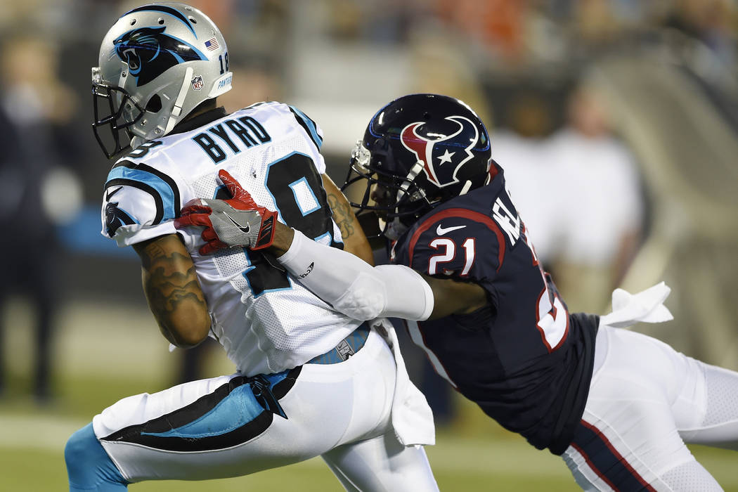 Carolina Panthers wide receiver Damiere Byrd (18) runs into the end zone for a touchdown against Houston Texans defensive back Marcus Gilchrist (21) during the first half of an NFL preseason footb ...