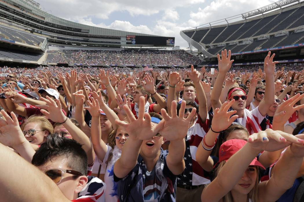 In this July 1, 2014, file photo, fans cheer for the United States against Belgium during a Brazil 2014 World Cup viewing party at Soldier Field in Chicago.  (AP Photo/Stacy Thacker, File)