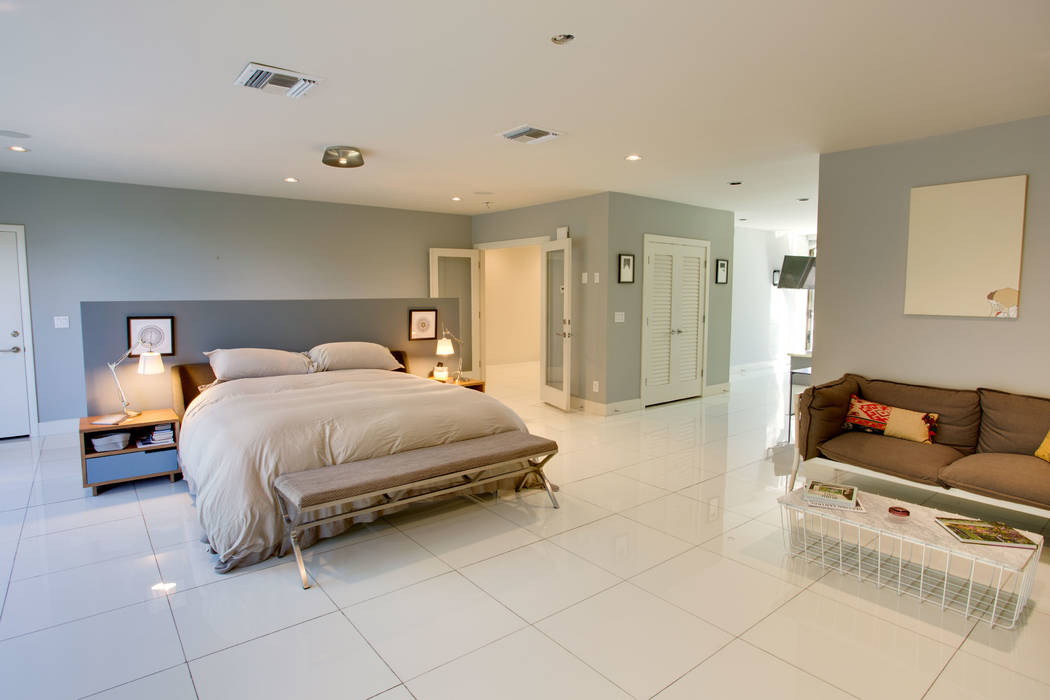 Large slabs of white, porcelain flooring are also found in the upstairs master bedroom. (Berkshire Hathaway HomeServices)
