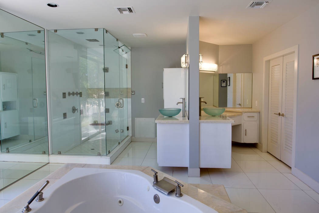 Berkshire Hathaway HomeServices The master bath has duel vanities facing each other.