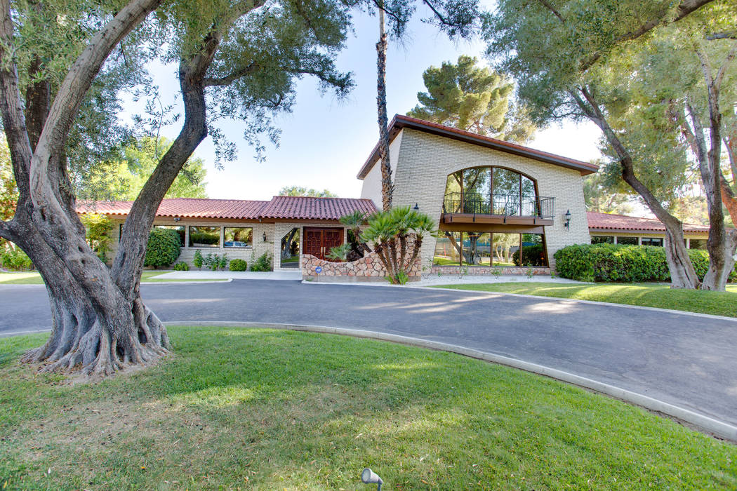 This midcentury Las Vegas home sits on a 1.25-acre lot dotted with olive trees. (Berkshire Hathaway HomeServices)