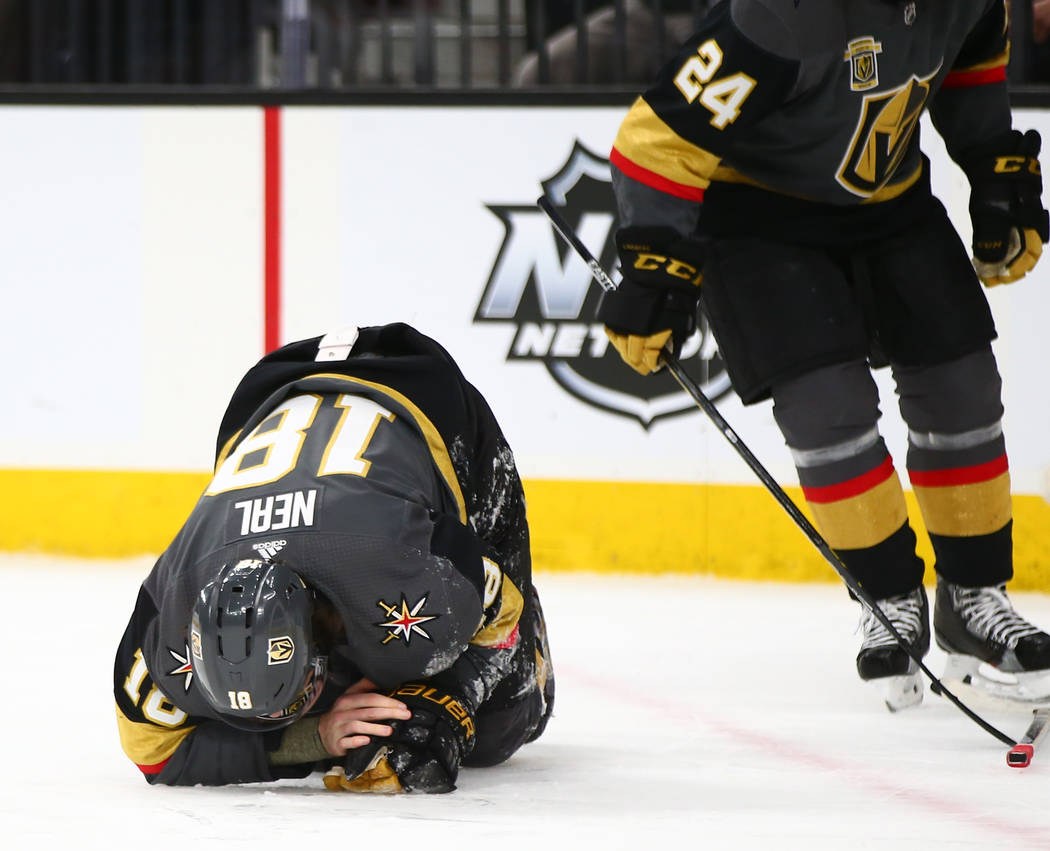 Golden Knights left wing James Neal (18) reacts after getting hit by the puck during an attempted shot against the Chicago Blackhawks during an NHL game at T-Mobile Arena in Las Vegas on Tuesday,  ...