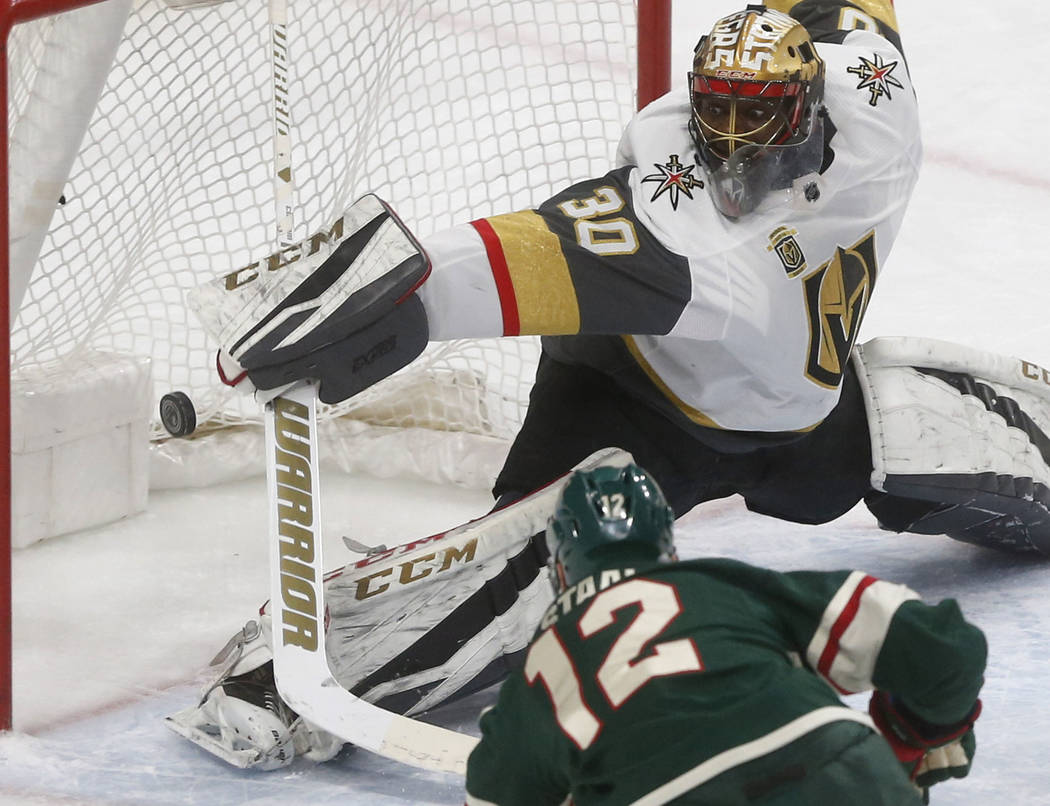Minnesota Wild's Eric Staal, front, scores on Vegas Golden Knights goalie Malcolm Subban during the first period of an NHL hockey game Friday, Feb. 2, 2018, in St. Paul, Minn. (AP Photo/Jim Mone)