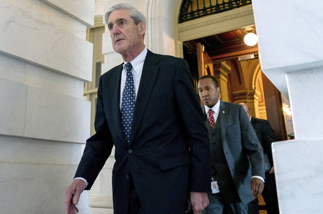 In this June 21, 2017, file photo, former FBI Director Robert Mueller, the special counsel probing Russian interference in the 2016 election, departs Capitol Hill following a closed door meeting i ...