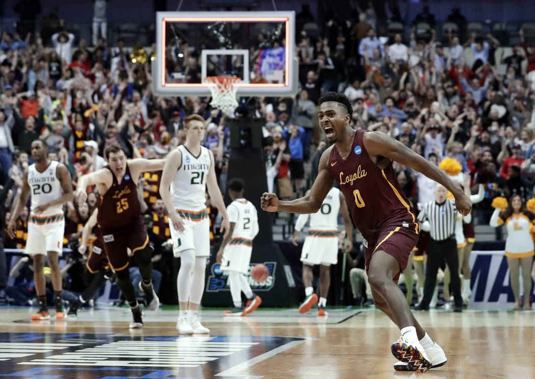 Loyola-Chicago guard Donte Ingram (0) celebrates sinking a three-point basket in the closing seconds of the second half of a first-round game against Miami at the NCAA college basketball tournamen ...