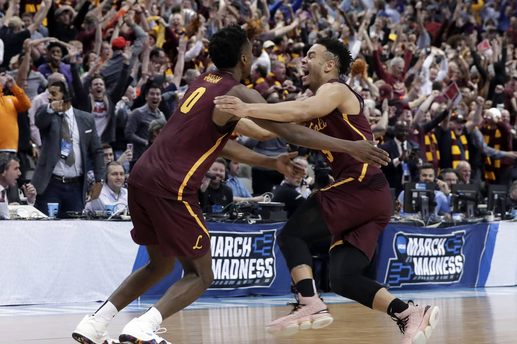 Loyola-Chicago guard Donte Ingram (0) and Marques Townes, right, celebrate their 64-62 win over Miami in a first-round game at the NCAA college basketball tournament in Dallas, Thursday, March 15, ...