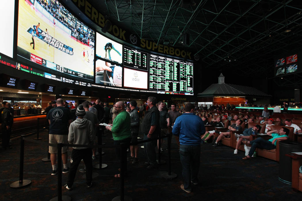 Guests watch and line up to bet on basketball games during the NCAA Tournament at the Westgate Superbook in Las Vegas Thursday, March 15, 2018. K.M. Cannon Las Vegas Review-Journal @KMCannonPhoto