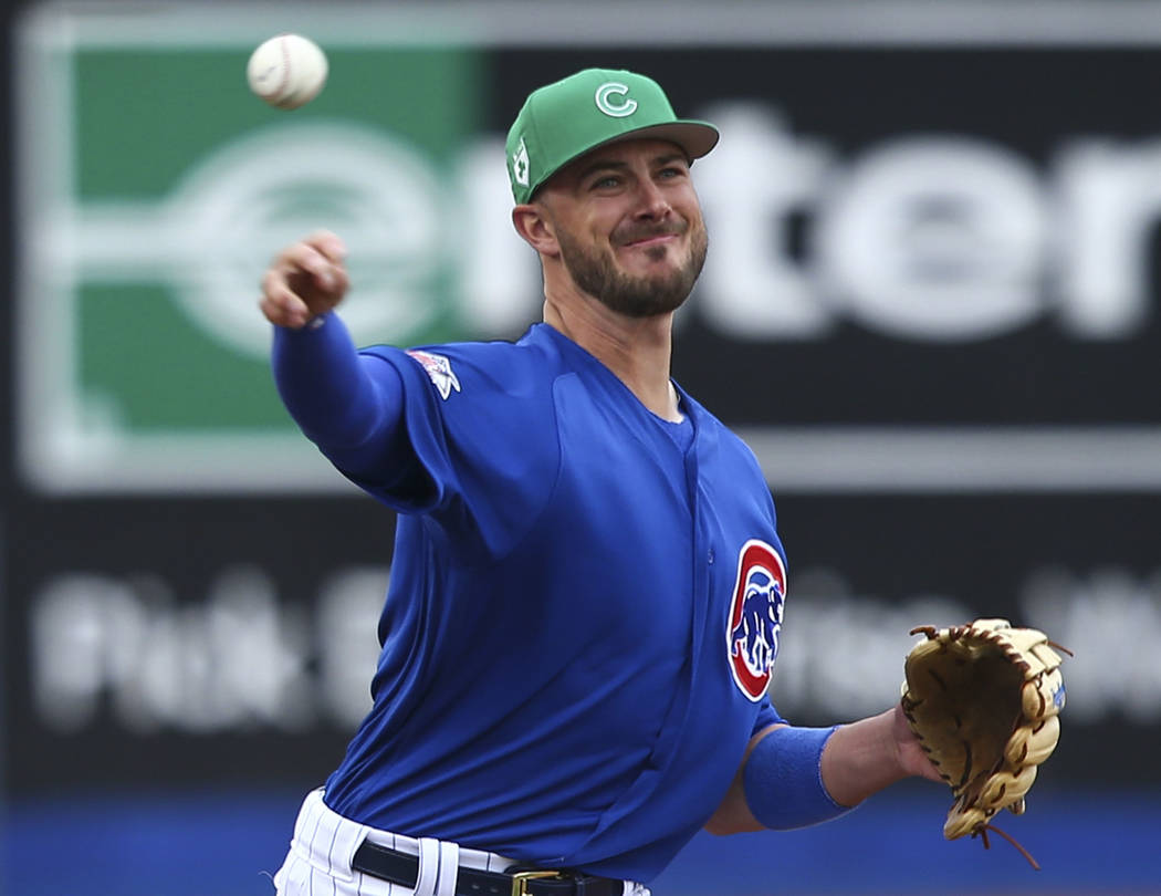 Chicago Cubs third baseman Kris Bryant (17) throws to first base while playing the Cleveland Indians in the annual Big League Weekend baseball game at Cashman Field in Las Vegas on Saturday, March ...