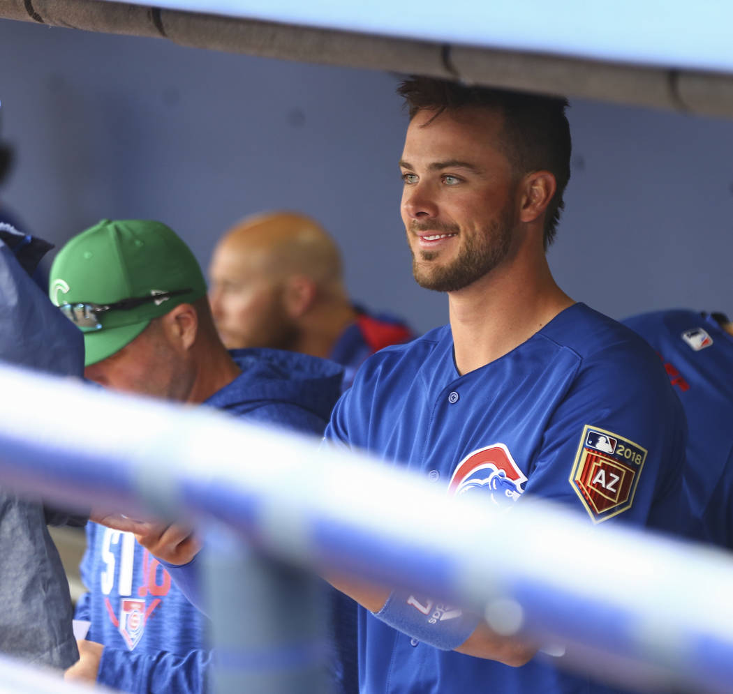 Chicago Cubs third baseman Kris Bryant autographs an item for a fan from the dugout before playing the Cleveland Indians in the annual Big League Weekend baseball game at Cashman Field in Las Vega ...