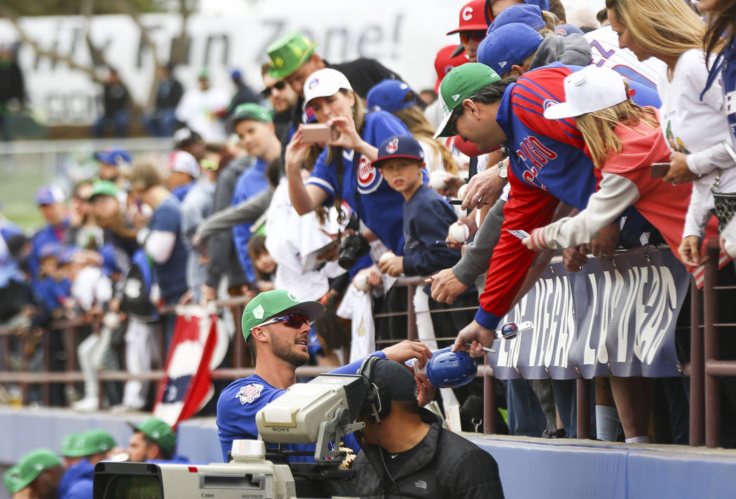 Chicago Cubs third baseman Kris Bryant autographs items for fans before playing the Cleveland Indians in the annual Big League Weekend baseball game at Cashman Field in Las Vegas on Saturday, Marc ...