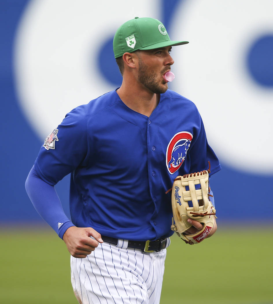 Chicago Cubs third baseman Kris Bryant blows bubblegum while returning to the dugout during the second inning while playing the Cleveland Indians in the annual Big League Weekend baseball game at  ...