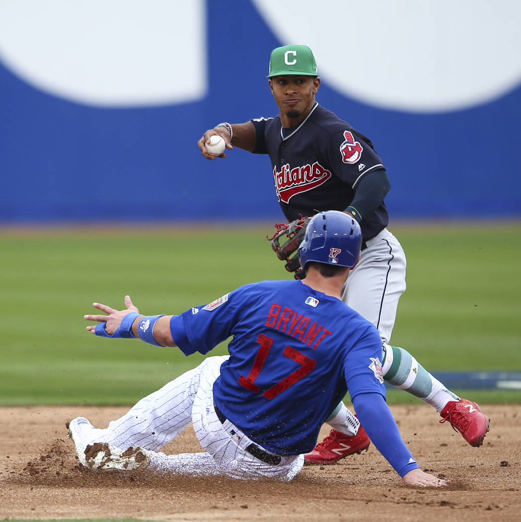Cleveland Indians shortstop Francisco Lindor looks to throw to first base after tagging out Chicago Cubs third baseman Kris Bryant (17) during the annual Big League Weekend baseball game at Cashma ...