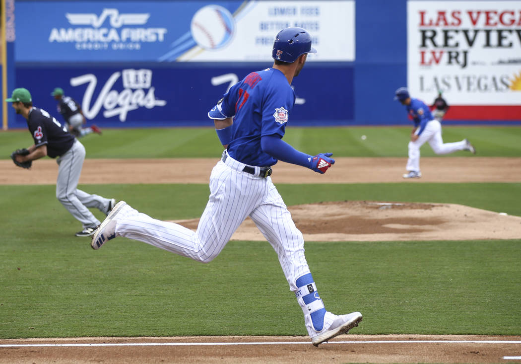 Chicago Cubs third baseman Kris Bryant (17) heads for first base against the Cleveland Indians during the annual Big League Weekend baseball game at Cashman Field in Las Vegas on Saturday, March 1 ...