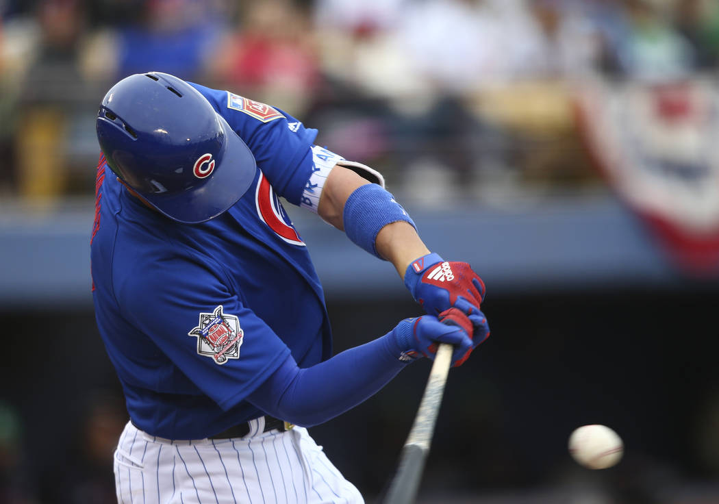 Chicago Cubs third baseman Kris Bryant strikes out swinging against the Cleveland Indians during the annual Big League Weekend baseball game at Cashman Field in Las Vegas on Saturday, March 17, 20 ...
