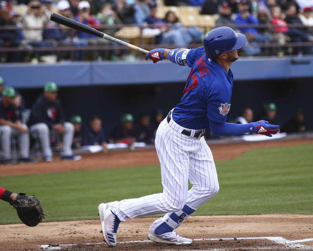 Chicago Cubs third baseman Kris Bryant (17) hits a single against the Cleveland Indians during the annual Big League Weekend baseball game at Cashman Field in Las Vegas on Saturday, March 17, 2018 ...