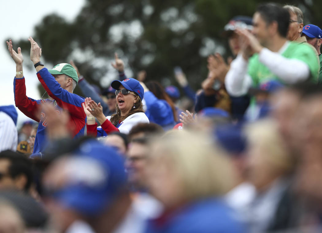 Chicago Cubs fans celebrate a home run by Chicago Cubs shortstop Addison Russell, not pictured, during the annual Big League Weekend baseball game against the Cleveland Indians at Cashman Field in ...