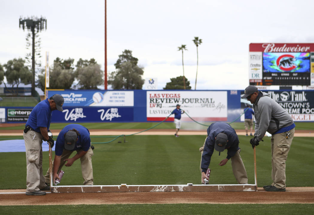 Markings are made on the field before the start of the annual Big League Weekend baseball game at Cashman Field in Las Vegas on Saturday, March 17, 2018. Chase Stevens Las Vegas Review-Journal @cs ...