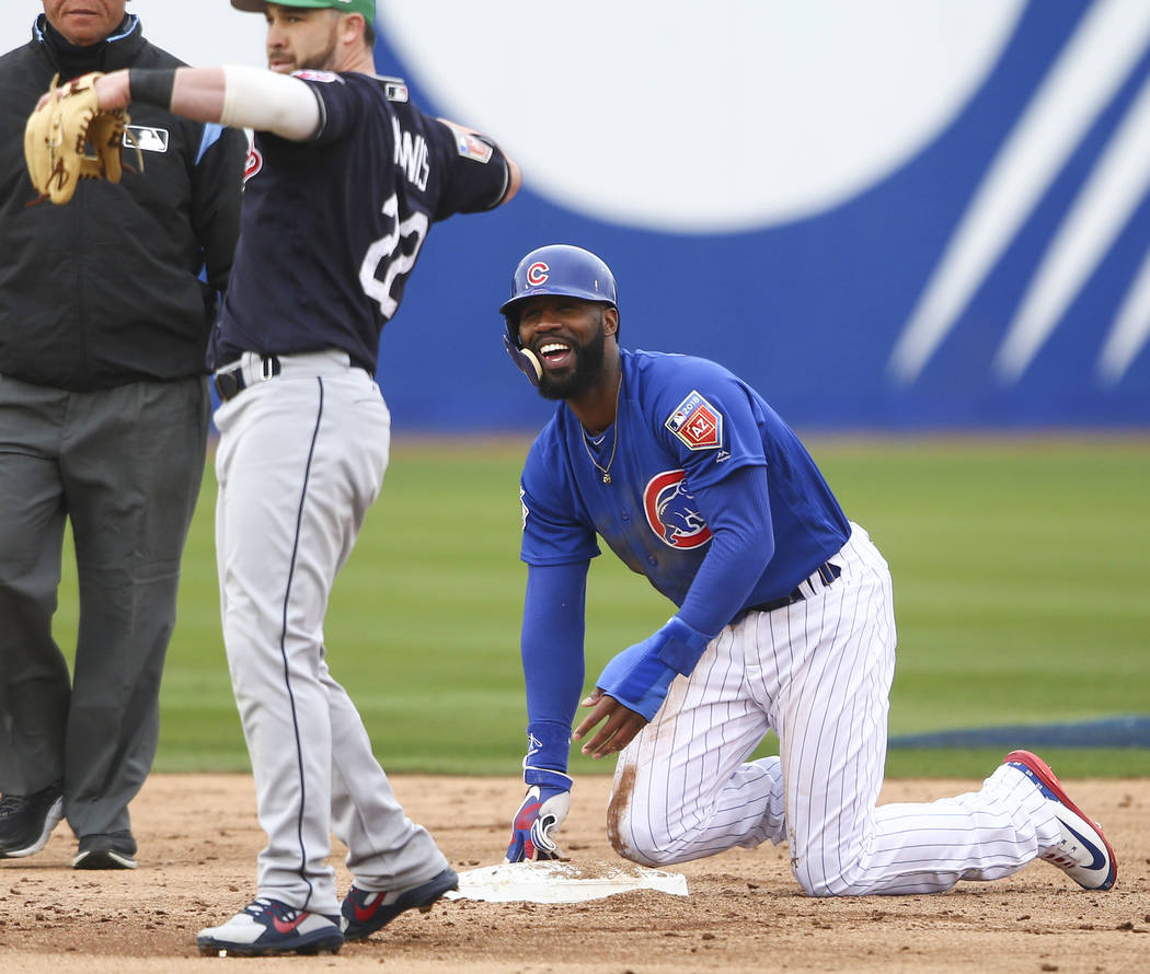 Chicago Cubs' Jason Heyward (22) reacts after making it safely to second base against Cleveland Indians second baseman Jason Kipnis (22) during an exhibition baseball game in Las Vegas on Saturday ...