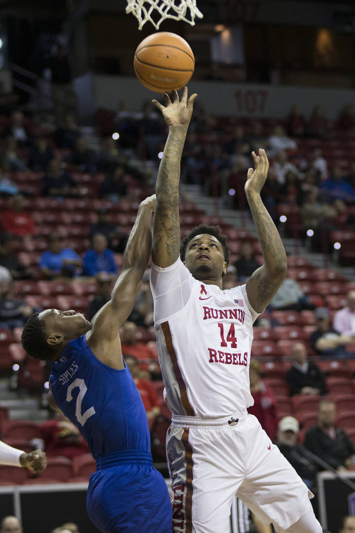 UNLV Rebels forward Tervell Beck (14) takes a shot against coverage from Air Force Falcons guard CJ Siples (2) in the first half of the Mountain West Conference men's basketball tournament ga ...