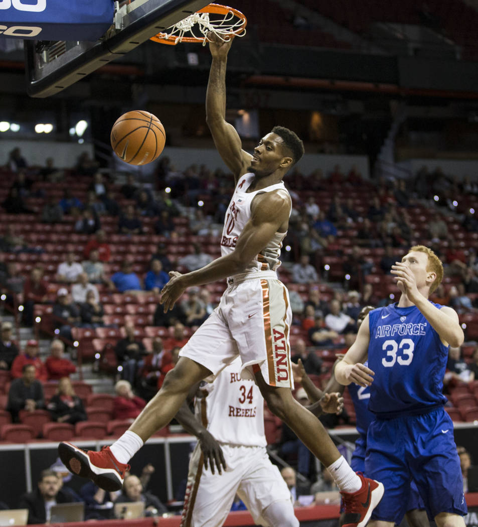 UNLV Rebels forward Shakur Juiston (10) dunks the ball as Air Force Falcons center Frank Toohey (33) looks on in the first half of the Mountain West Conference men's basketball tournament gam ...