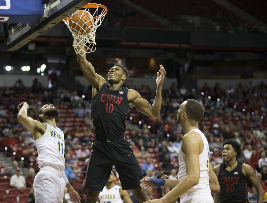 UNLV Rebels forward Shakur Juiston (10) makes a dunk in the first half of the Mountain West Conference men's basketball tournament game at the Thomas & Mack Center in Las Vegas, Thursday, Marc ...