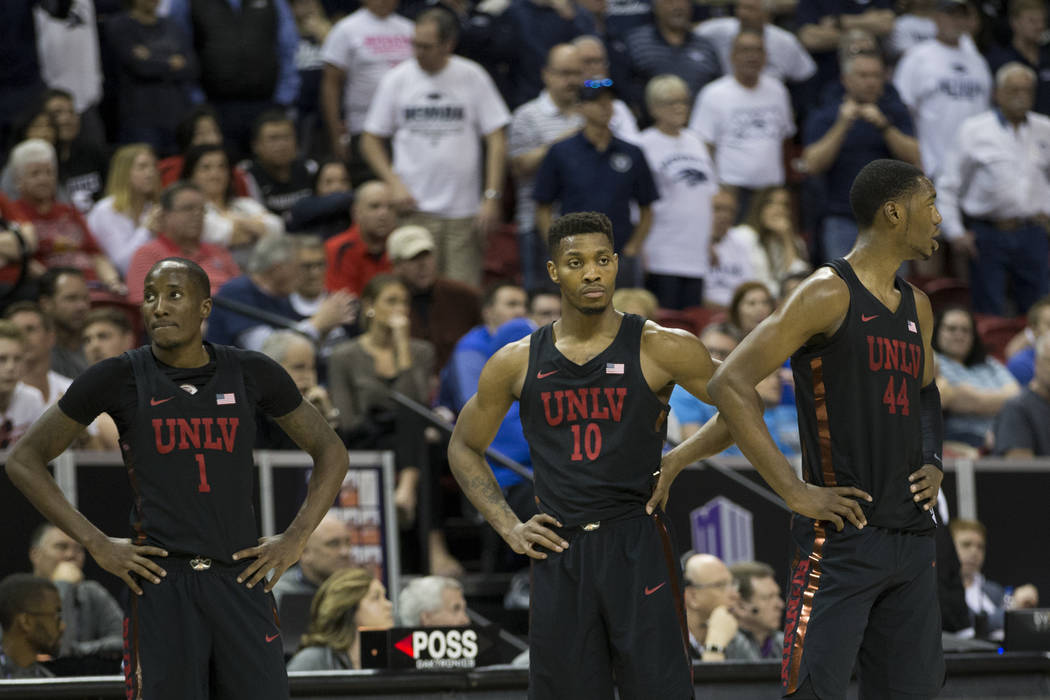 UNLV Rebels guard Kris Clyburn (1), forward Shakur Juiston (10) and forward Brandon McCoy (44) wait for play to resume in the second half of the Mountain West Conference men's basketball tournamen ...