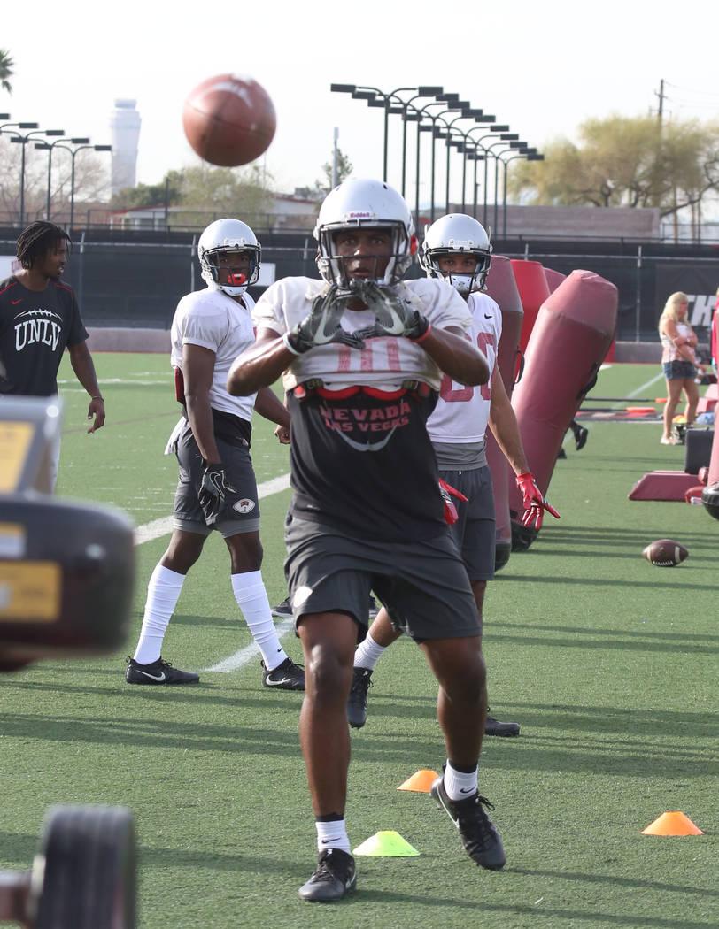 UNLV wide receiver Darren Woods Jr. (10) prepares to catch the ball during team practice on Tuesday, March 13, 2018, in Las Vegas. Bizuayehu Tesfaye/Las Vegas Review-Journal @bizutesfaye