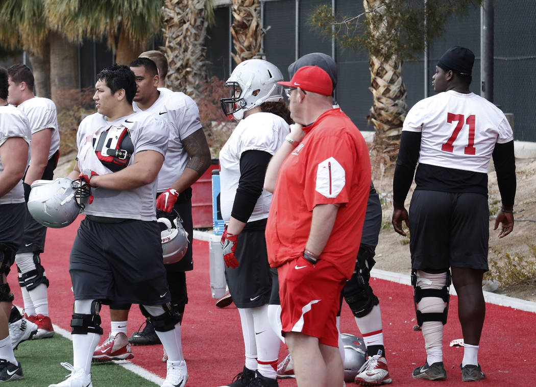 UNLV center Sid Acosta, left, prepares to enter the field as Justice Oluwaseun (71) walks on the sideline during team practice on Tuesday, March 20, 2018, in Las Vegas. Bizuayehu Tesfaye/Las Vegas ...