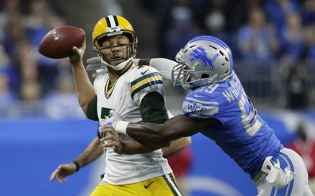 Detroit Lions outside linebacker Tahir Whitehead (59) pressures Green Bay Packers quarterback Brett Hundley (7) during the first half of an NFL football game, Sunday, Dec. 31, 2017, in Detroit. (A ...