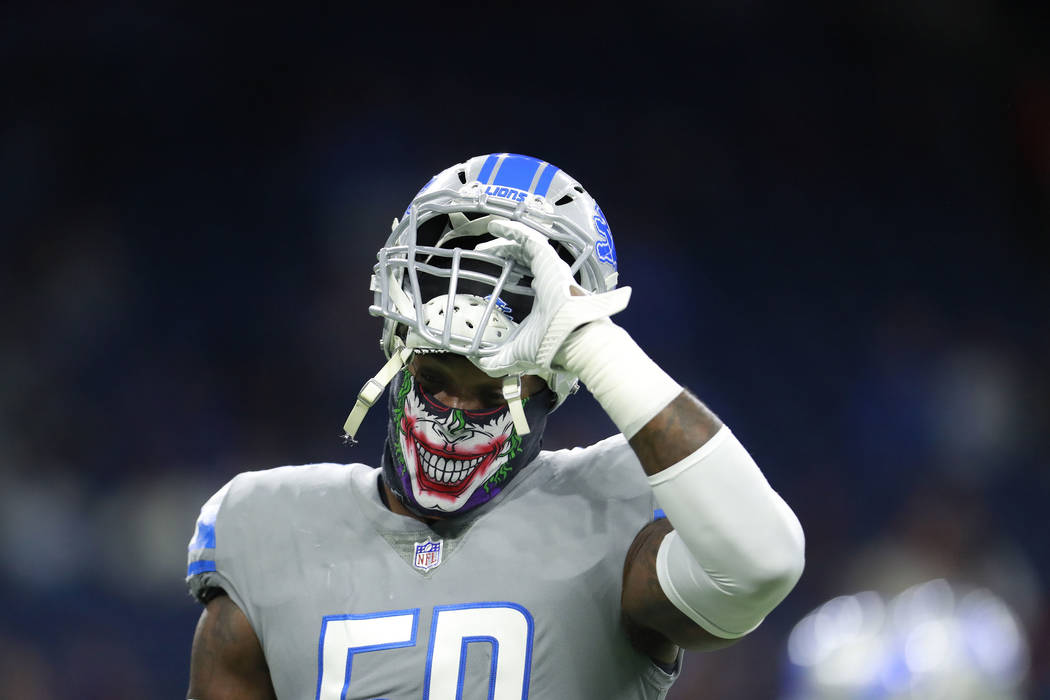 Detroit Lions outside linebacker Tahir Whitehead (59) removes his helmet during warmups before an NFL football game against the Chicago Bears, Saturday, Dec. 16, 2017, in Detroit. (AP Photo/Rey De ...