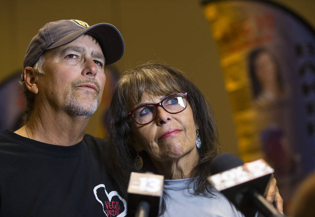 Chris Davis, left, and Debbie Davis, parents of Neysa Tonks, who was killed in the Oct. 1 shooting, talk about the tribute flags bearing the names and photos of the victims at the Westgate in Las  ...