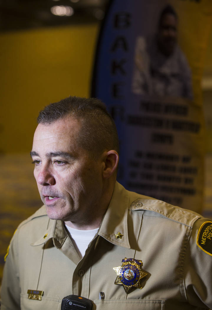 Metropolitan Polce Department Capt. Andrew Walsh talks about the presentation of flags bearing the names and photos of the victims of the Oct. 1 shooting at the Westgate in Las Vegas on Thursday,  ...