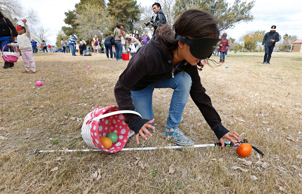 Las Vegas resident Marley Rupp, 8, with visual impairment look for beeping eggs during the Beepin' Egg Hunt at Sunset Park in Las Vegas, Saturday, March 24, 2018. Nevada Blind Children's Foundatio ...
