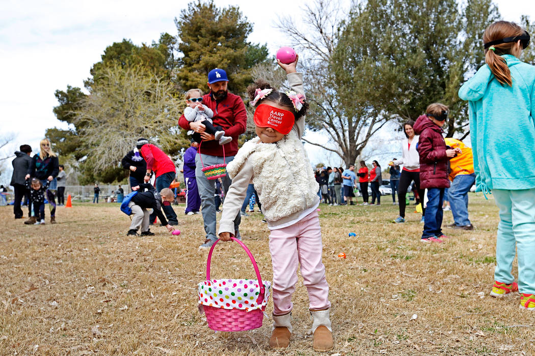 Layla Stover, 4, of Las Vegas holds up a beeping egg during the Beepin' Egg Hunt at Sunset Park in Las Vegas, Saturday, March 24, 2018. Nevada Blind Children's Foundation hosted the egg hunt for v ...