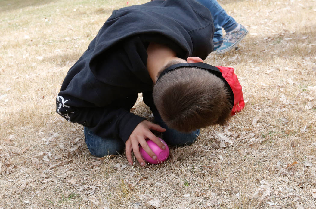 Johnny Gonzales Lamb, 11, of Las Vegas with a blindfold listens to a beeping egg during the Beepin' Egg Hunt at Sunset Park in Las Vegas, Saturday, March 24, 2018. Nevada Blind Children's Foundati ...