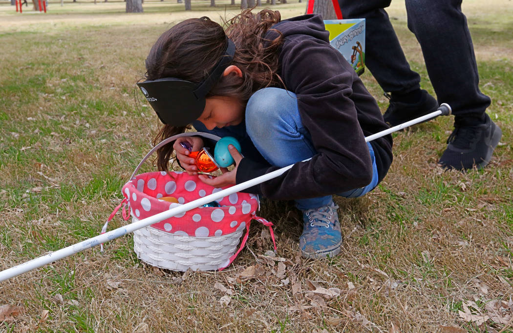 Las Vegas resident Marley Rupp, 8, with visual impairment checks Easter eggs she collected during the Beepin' Egg Hunt at Sunset Park in Las Vegas, Saturday, March 24, 2018. Nevada Blind Children' ...