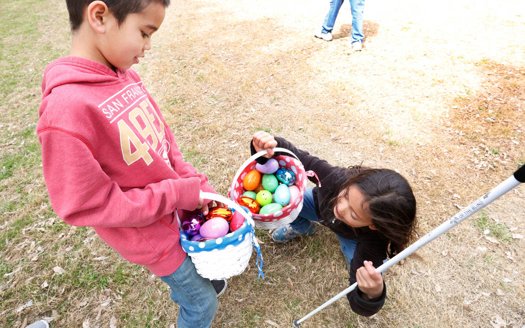 Las Vegas resident Marley Rupp, 8 with visual impairment shows her Easter basket to her brother Jackson, 6, after the Beepin' Egg Hunt at Sunset Park in Las Vegas, Saturday, March 24, 2018. Nevada ...