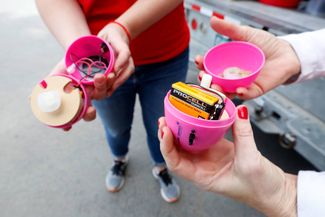 Nevada Blind Children's Foundation staffers Veronica Atkins, left, and Leslie Jones show battery-operated beeping plastic eggs, which have been used for the Beepin' Egg Hunt at Sunset Park in Las  ...