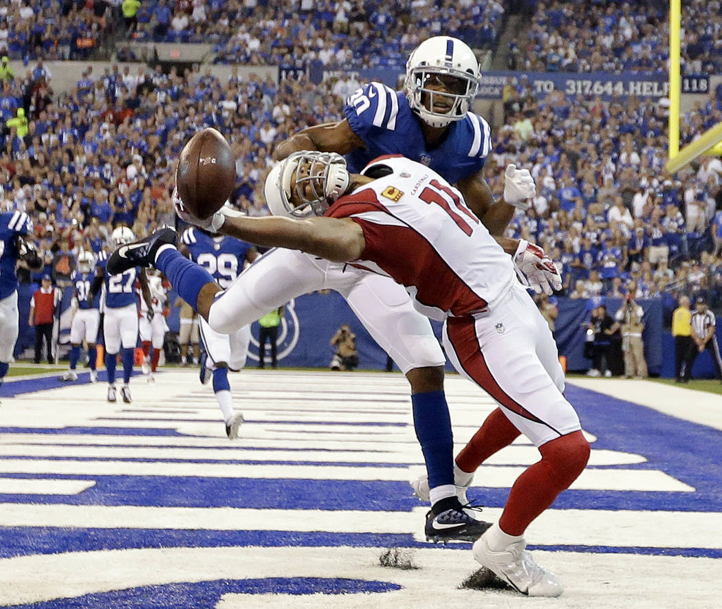 Arizona Cardinals' Larry Fitzgerald (11) tries to make a catch while being defended by Indianapolis Colts' Rashaan Melvin during the first half of an NFL football game Sunday, Sept. 17, 2017, in I ...