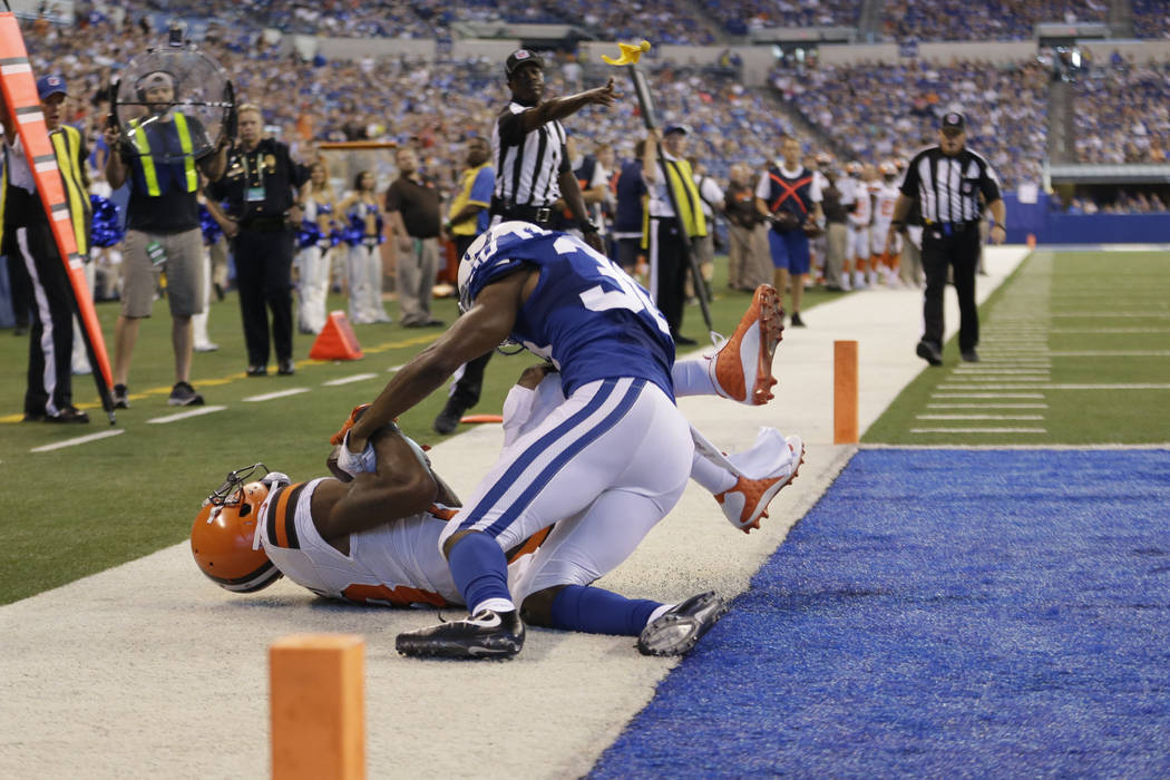 Cleveland Browns wide receiver Kenny Britt (18) makes a catch in the end zone for a touchdown under Indianapolis Colts cornerback Rashaan Melvin (30) during the second half of an NFL football game ...