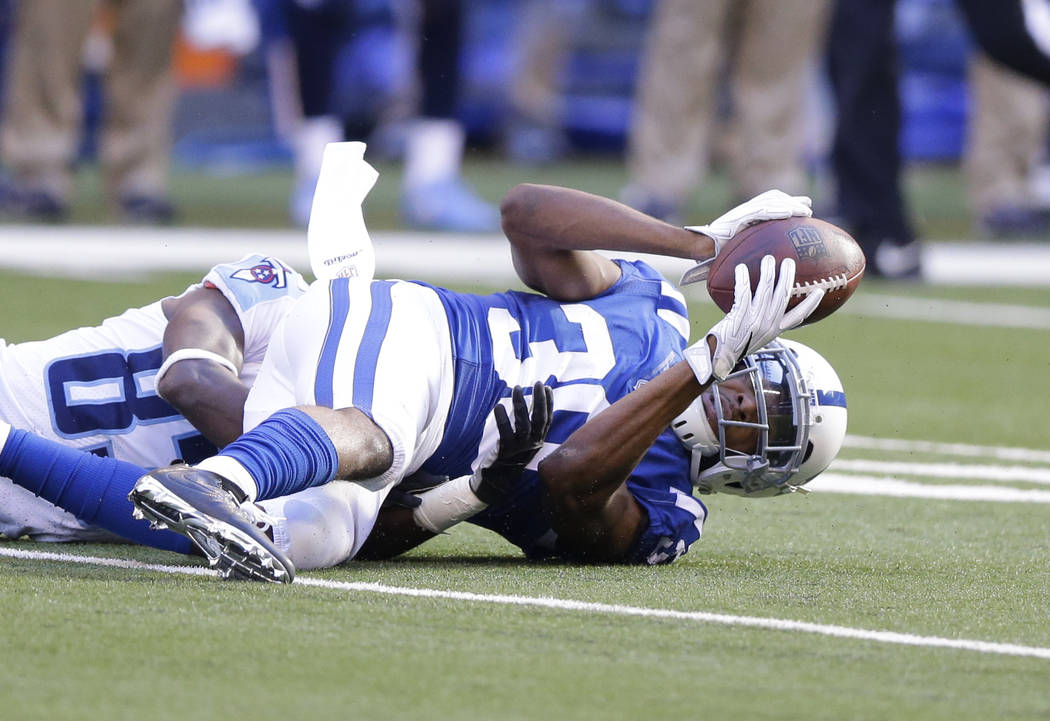 Indianapolis Colts' Rashaan Melvin (30) makes an interception during the first half of an NFL football game against the Tennessee Titans, Sunday, Nov. 26, 2017, in Indianapolis. (AP Photo/Michael  ...
