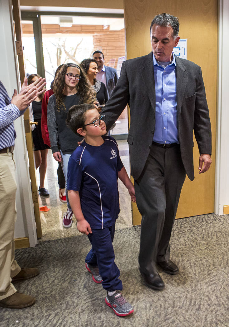 Danny Tarkanian walks in to file for his candidacy for the 3rd Congressional District of Nevada with his son, Jerry Tarkanian Jr., at the Clark County Government Center in Las Vegas on Friday, Mar ...