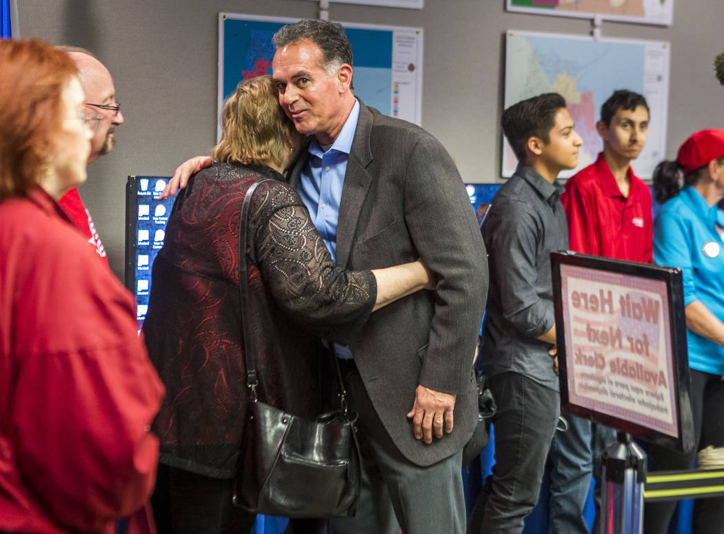 Danny Tarkanian hugs a supporter before filiing for his candidacy for the 3rd Congressional District of Nevada at the Clark County Government Center in Las Vegas on Friday, March 16, 2018, after d ...
