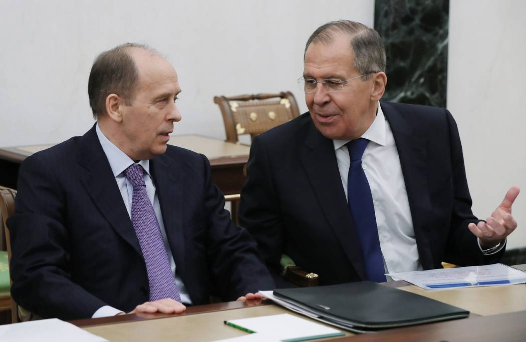 Russian Foreign Minister Sergey Lavrov speaks to Federal Security Service (FSB) Director Alexander Bortnikov as they attend a security council meeting in the Kremlin in Moscow, Russia, Thursday, M ...