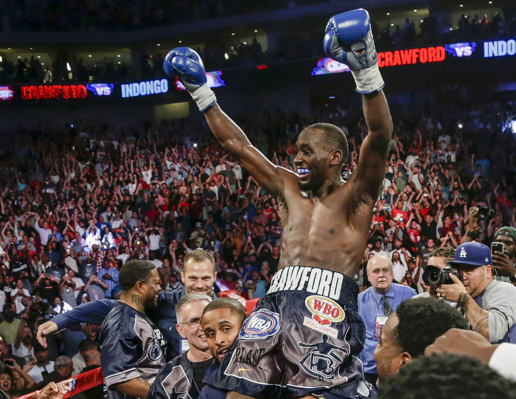 """Terence """"Bud"""" Crawford celebrates his win by knockout against Julius Indongo in the third round of a junior welterweight world title unification bout in Lincoln, Neb., Saturday, Aug. 19, ..."""