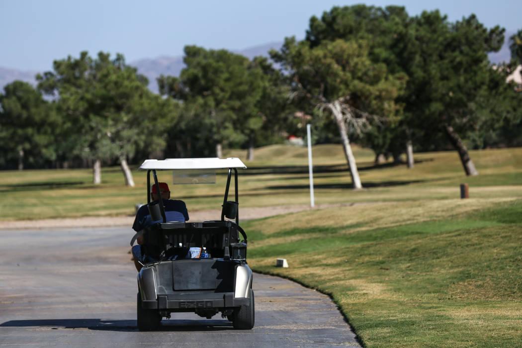 A worker drives at Legacy Golf Club in Henderson, Thursday, Oct. 12, 2017. Joel Angel Juarez Las Vegas Review-Journal @jajuarezphoto