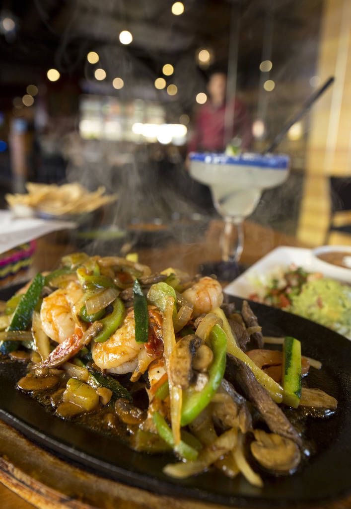 The carne asada and shrimp parillada (fajitas) entree served with the chips and salsa trio and a traditional margarita at Leticia's Mexican Cocina located at Tivoli Village at Queensridge in Las V ...