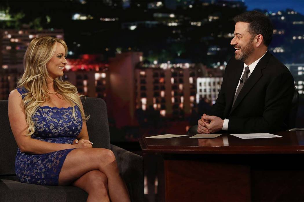 """Adult film star Stormy Daniels laughs with host Jimmy Kimmel during an appearance on """"Jimmy Kimmel Live!"""" Tuesday, Jan. 30, 2018, in Los Angeles. (Randy Holmes/ABC via AP)"""